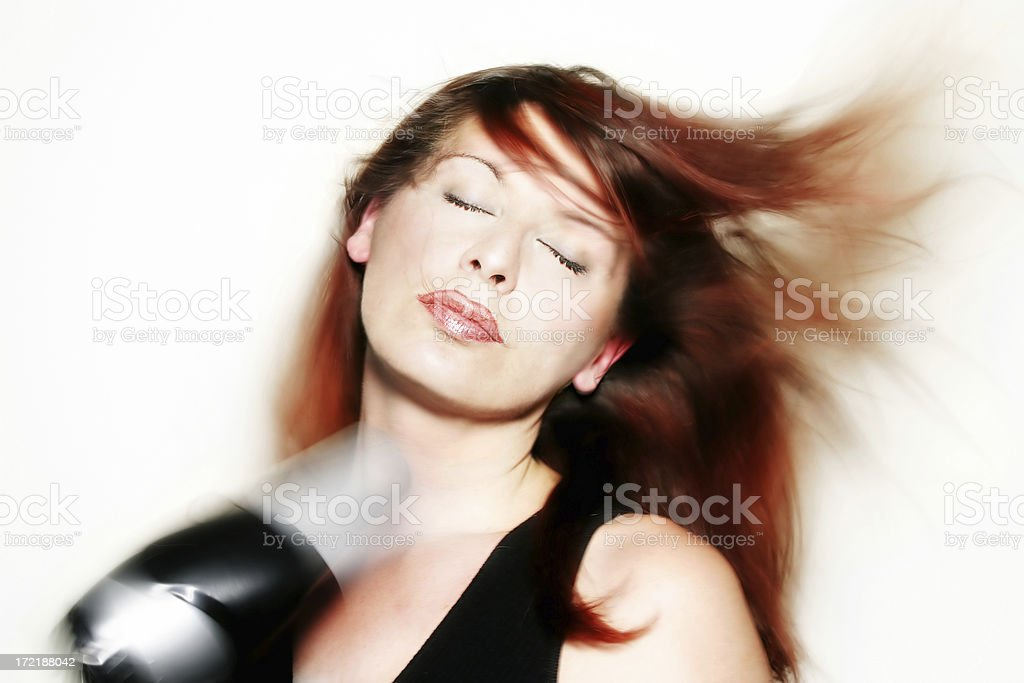Woman drying her hair royalty-free stock photo