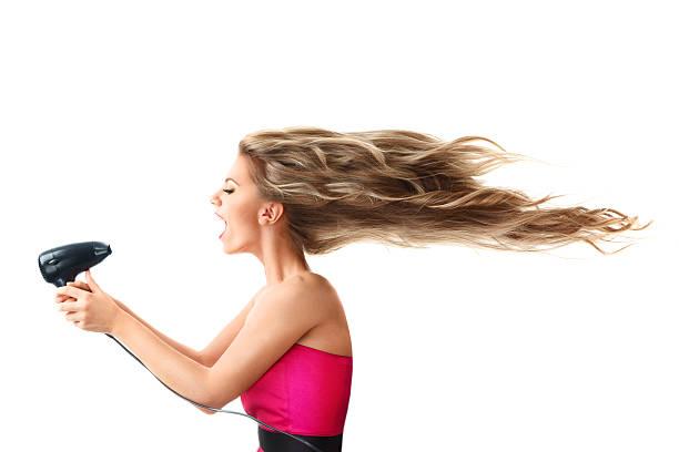 frau trocknen langes haar mit ventilator - haarfön stock-fotos und bilder