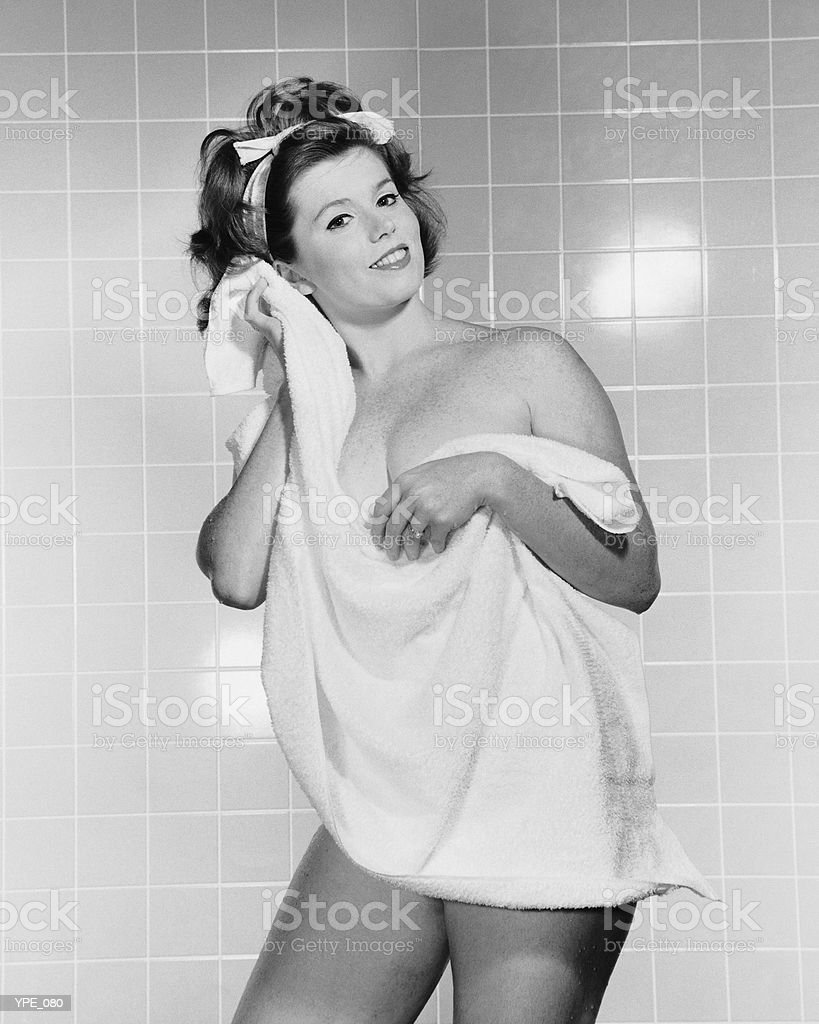 Woman drying off with towel royalty-free stock photo