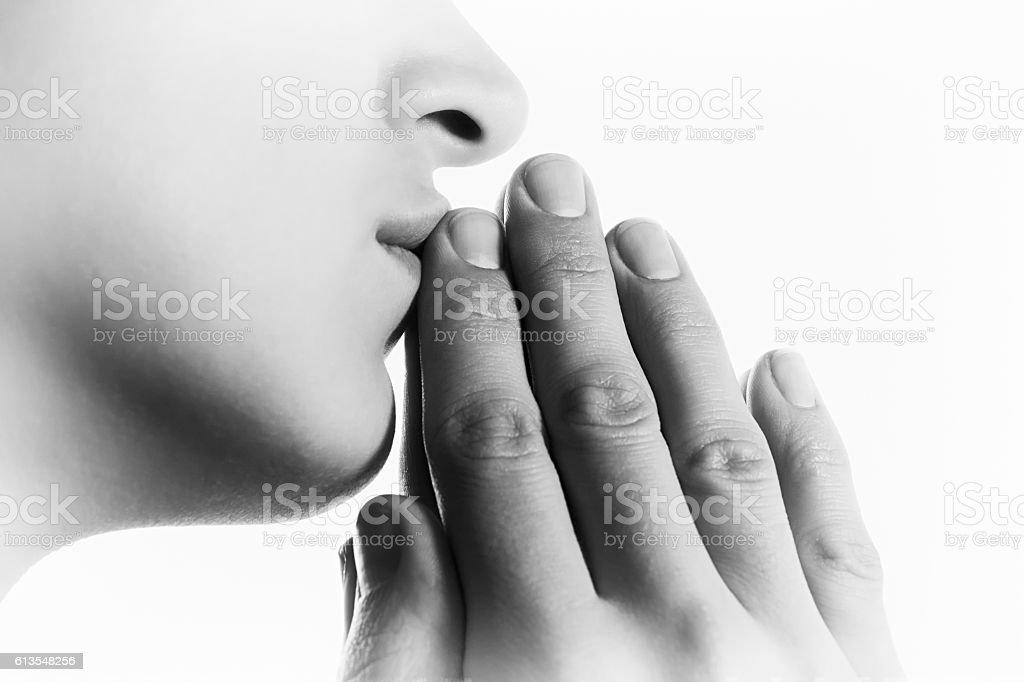 Woman  during a prayer b-w stock photo