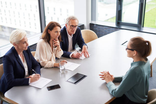 Woman during job interview and three elegant members of management Woman during job interview and three elegant members of management job interview stock pictures, royalty-free photos & images