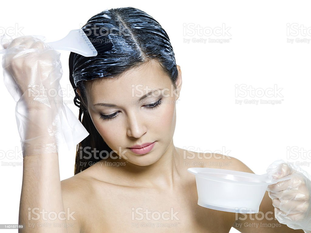 woman dyeing brown hairs royalty-free stock photo