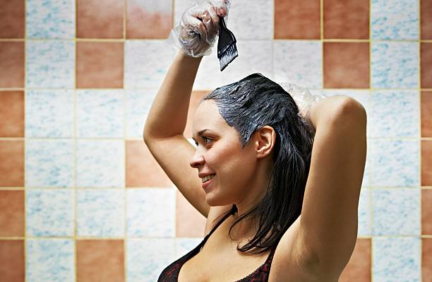 woman dyeing hairs stock photo