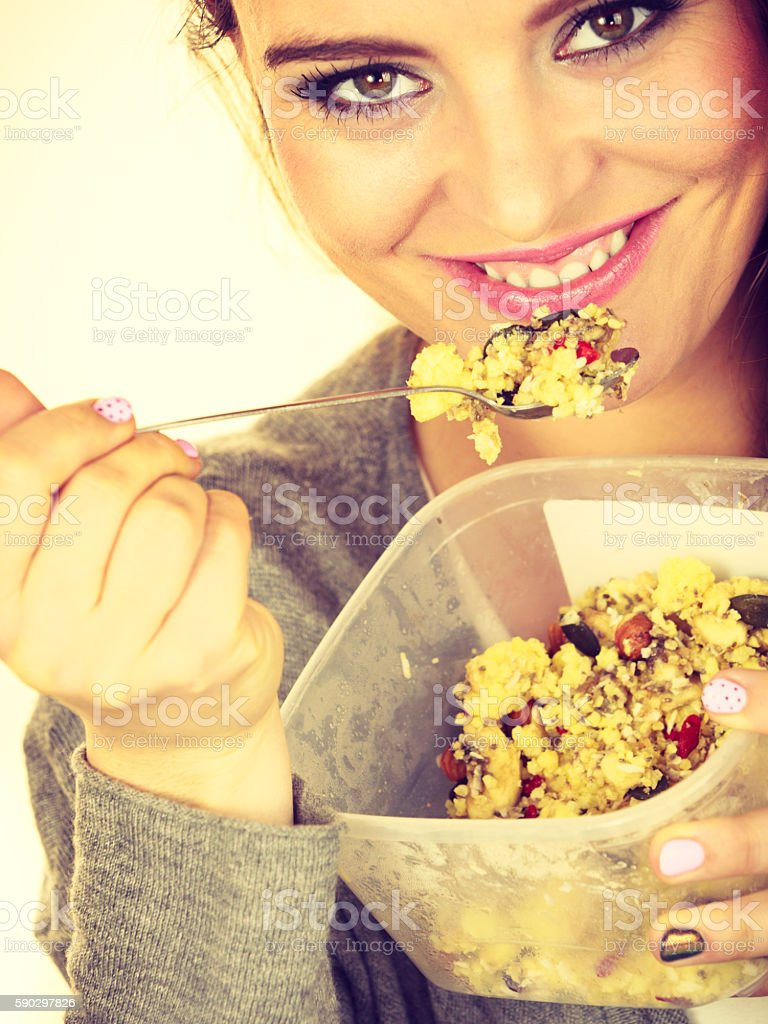 Woman eat oatmeal with dry fruits. Dieting Стоковые фото Стоковая фотография