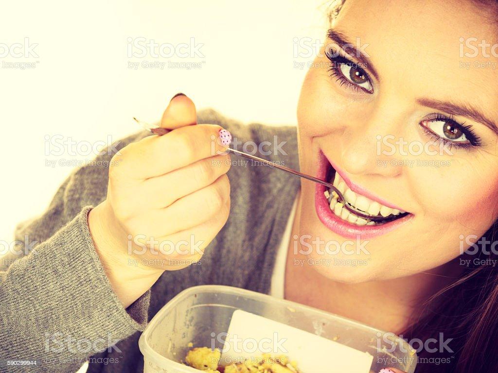 Woman eat oatmeal with dry fruits. Dieting royaltyfri bildbanksbilder