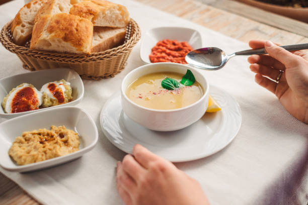 Woman eat traditional Cappadocia food from lentil soup stock photo
