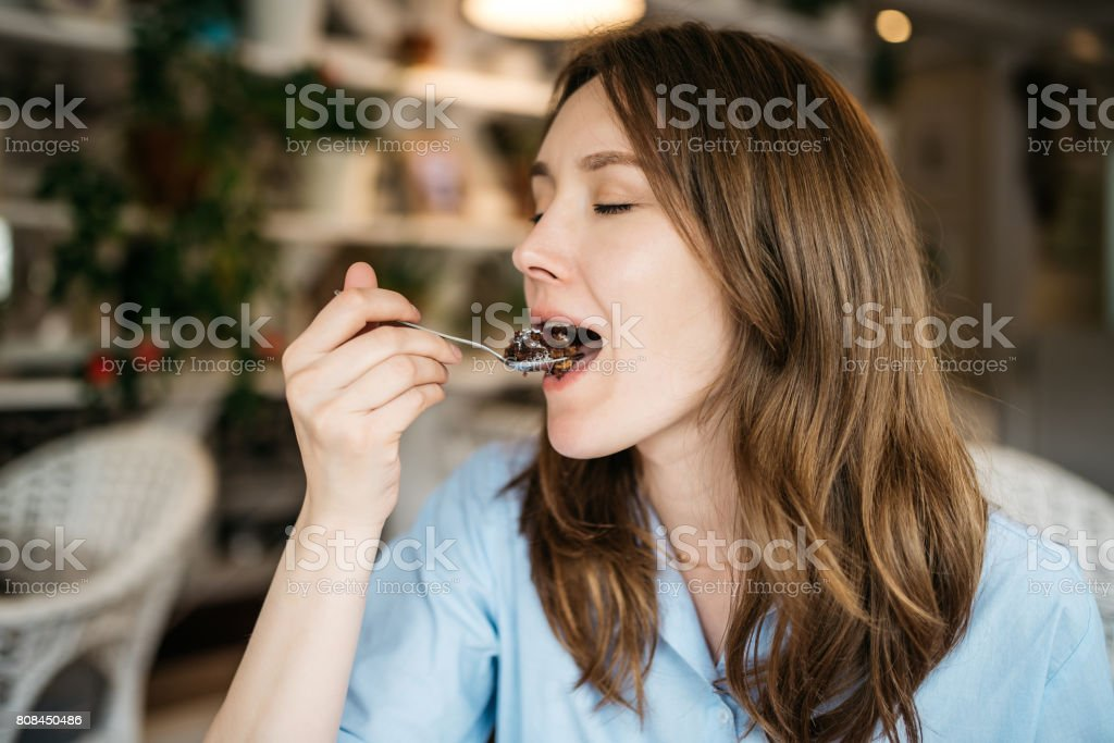 Woman eating a cake royalty-free stock photo