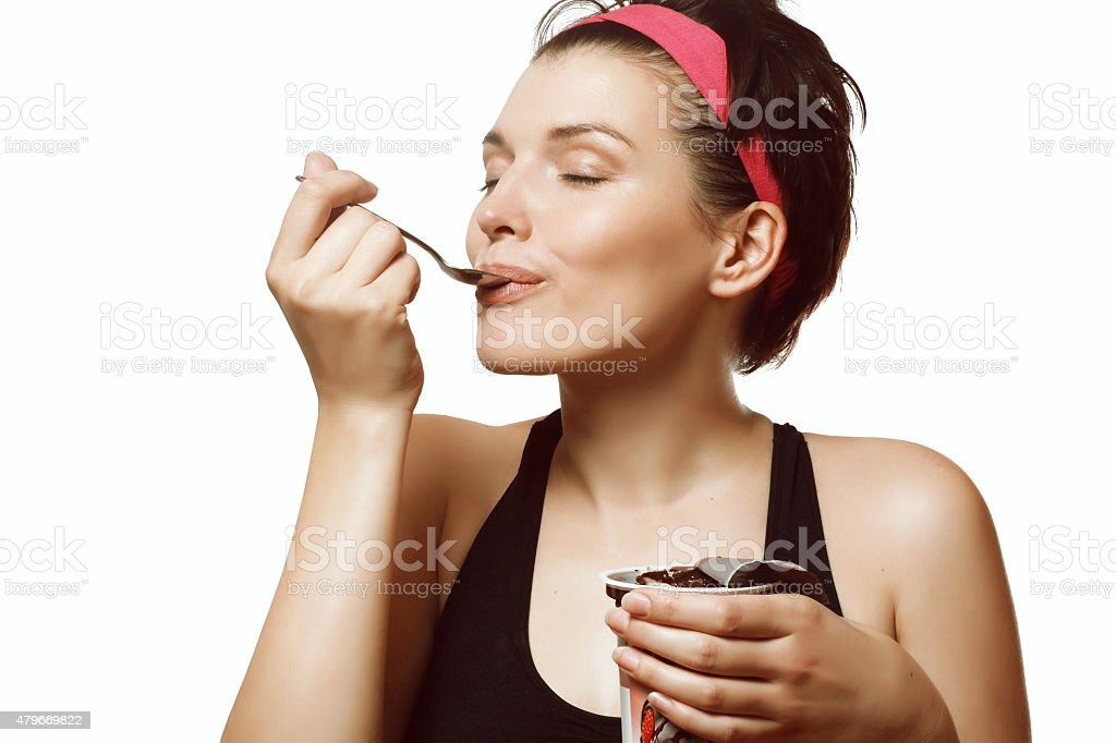woman eating a delicious ice cream with chocolate stock photo