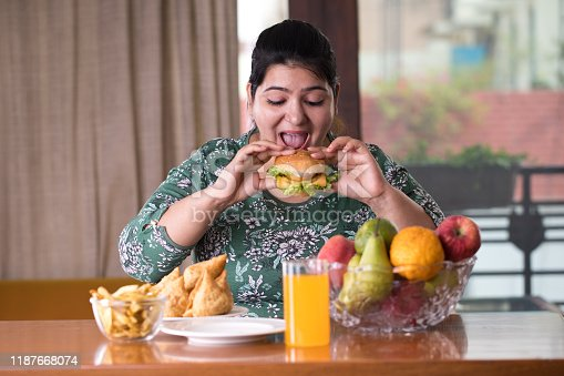 woman eating a fast food burger