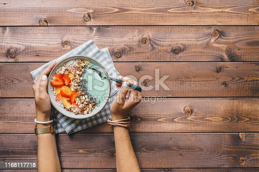Spirulina smoothie bowl topped with berries, granola, and chia seeds