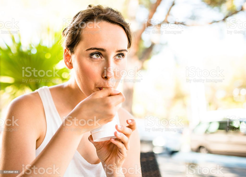 woman eating an icecream on summer stock photo