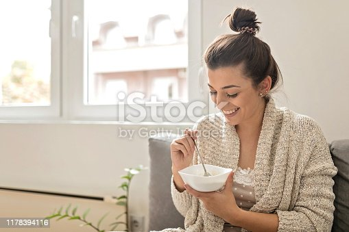 istock Woman eating an oatmeal 1178394116