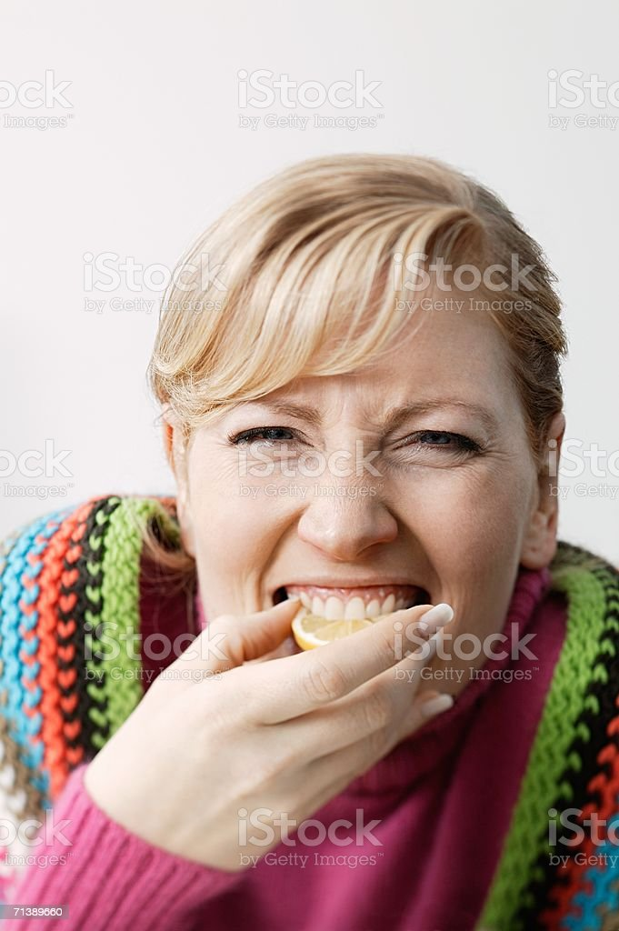 Woman eating an orange royalty-free stock photo