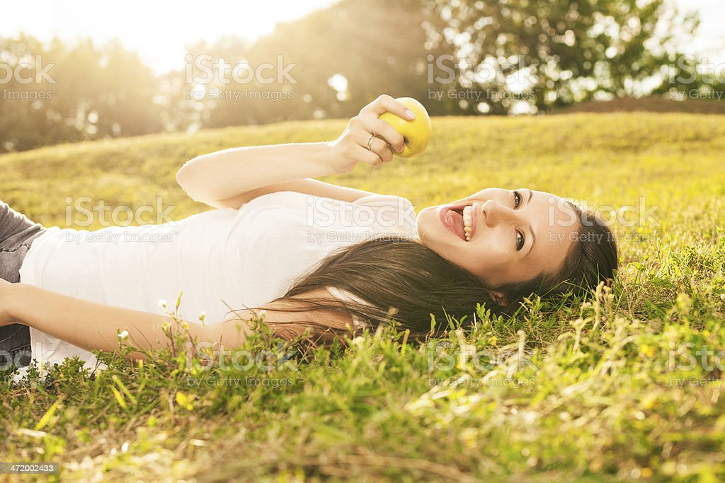 Woman eating apple stock photo