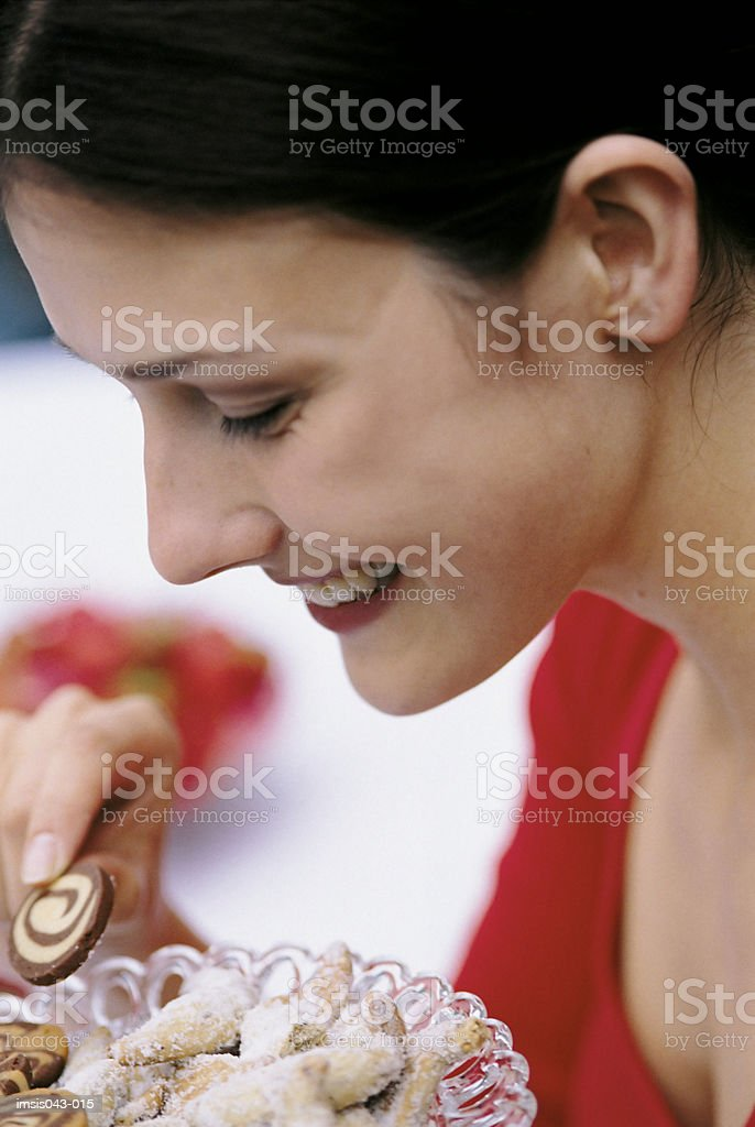 Woman eating biscuit royalty-free stock photo