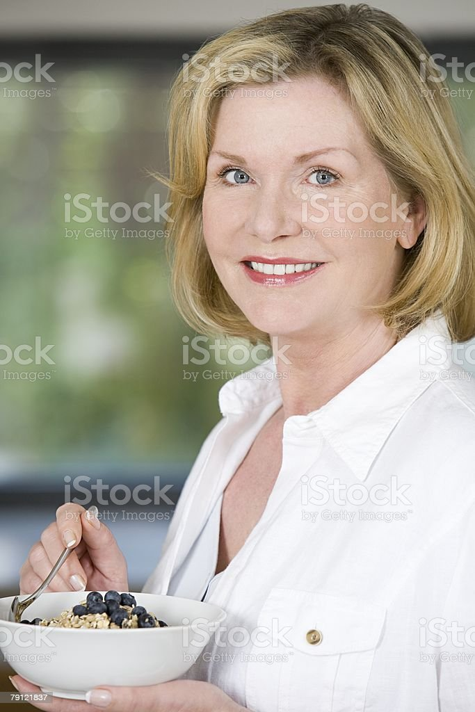 Woman eating blueberries and cereal royalty-free stock photo
