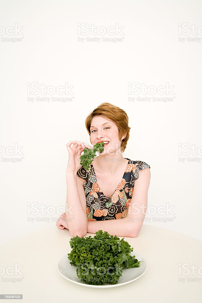 A woman eating cabbage 免版稅 stock photo