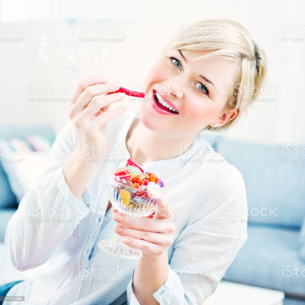 Woman eating candy royalty-free stock photo