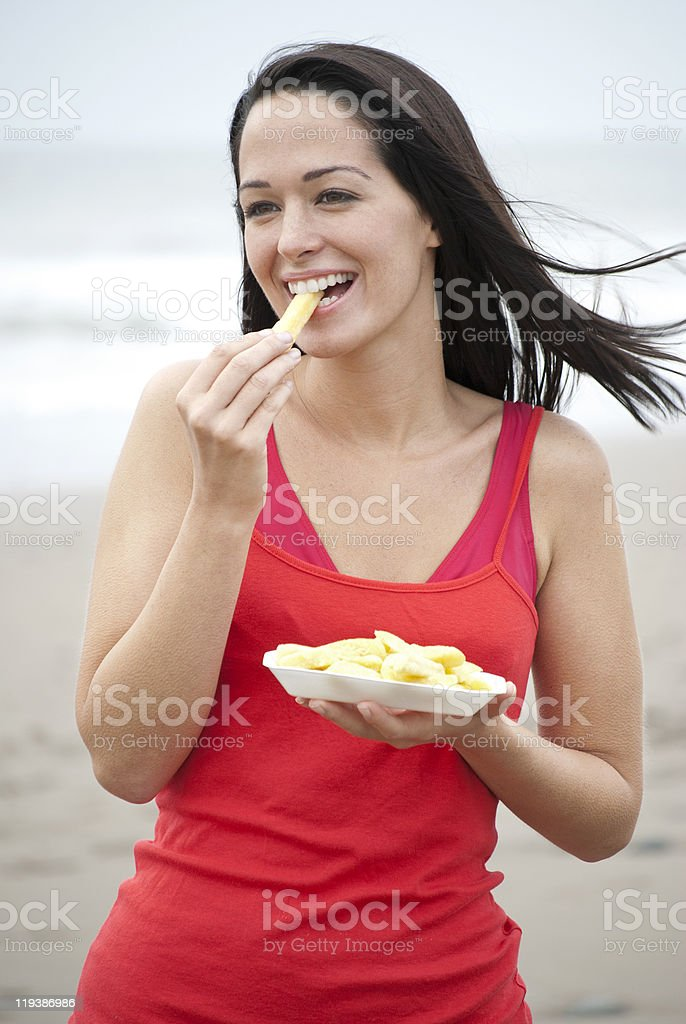 Woman eating chips royalty-free stock photo