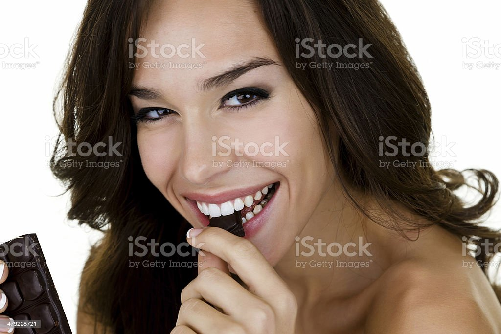 Woman eating chocolate royalty-free stock photo