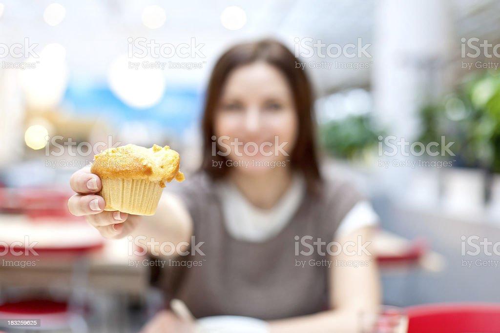 Woman eating cupcake royalty-free stock photo