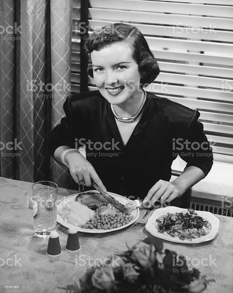 Woman eating dinner (B&W), elevated view stock photo