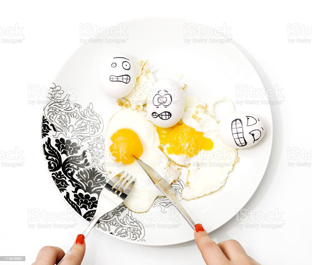 woman eating eggs royalty-free stock photo