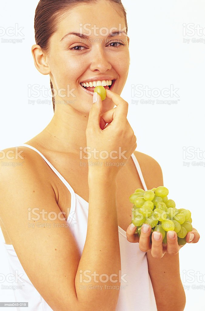 Woman eating grapes 免版稅 stock photo