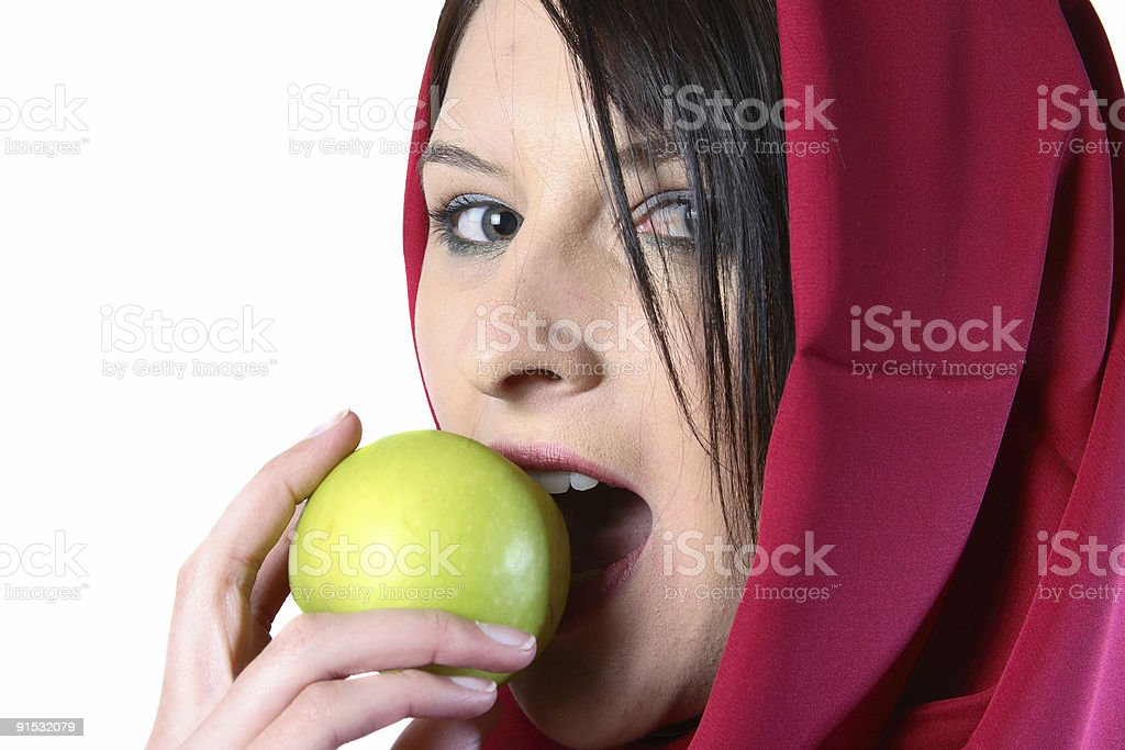 Woman eating green apple royalty-free stock photo