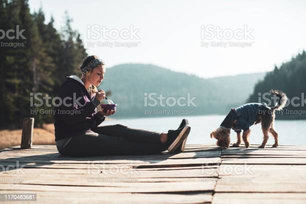 Photo of Woman eating healthy food outdoor.