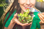 istock Woman eating healthy salad 850141658