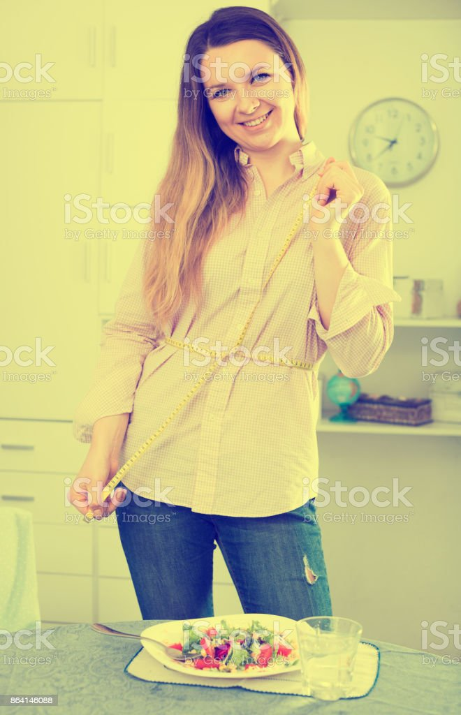 Woman eating healthy to lose weight royalty-free stock photo