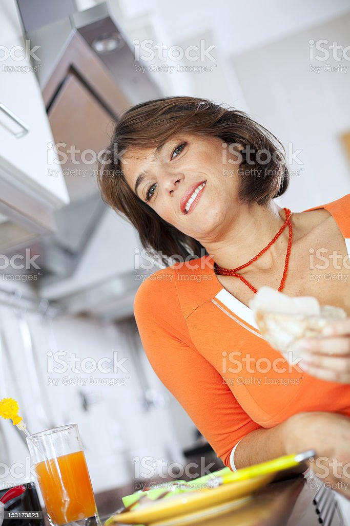 Woman eating her breakfast royalty-free stock photo