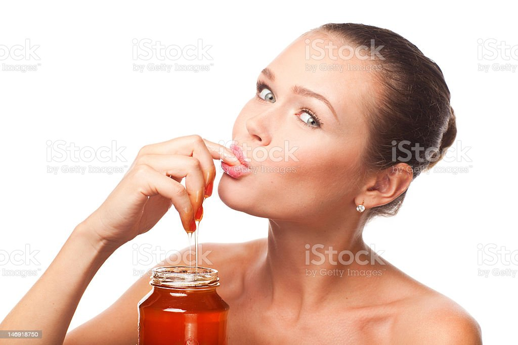 woman eating honey stock photo
