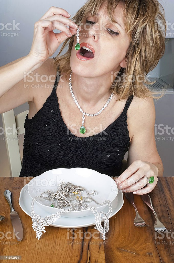 Woman Eating Jewelleries royalty-free stock photo