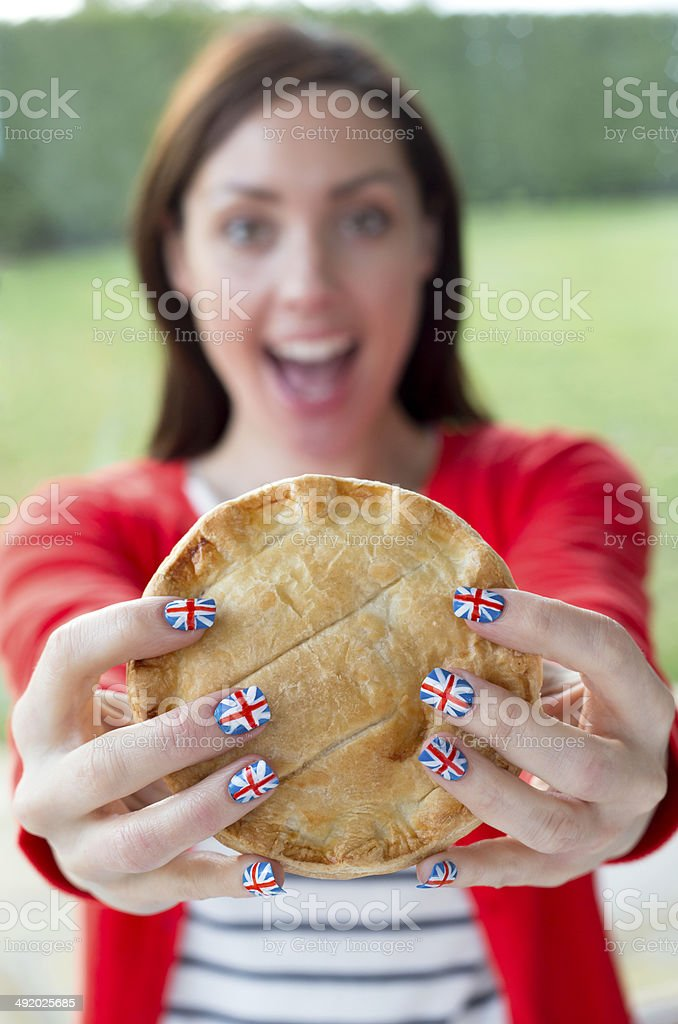 Woman Eating Meat Pie stock photo