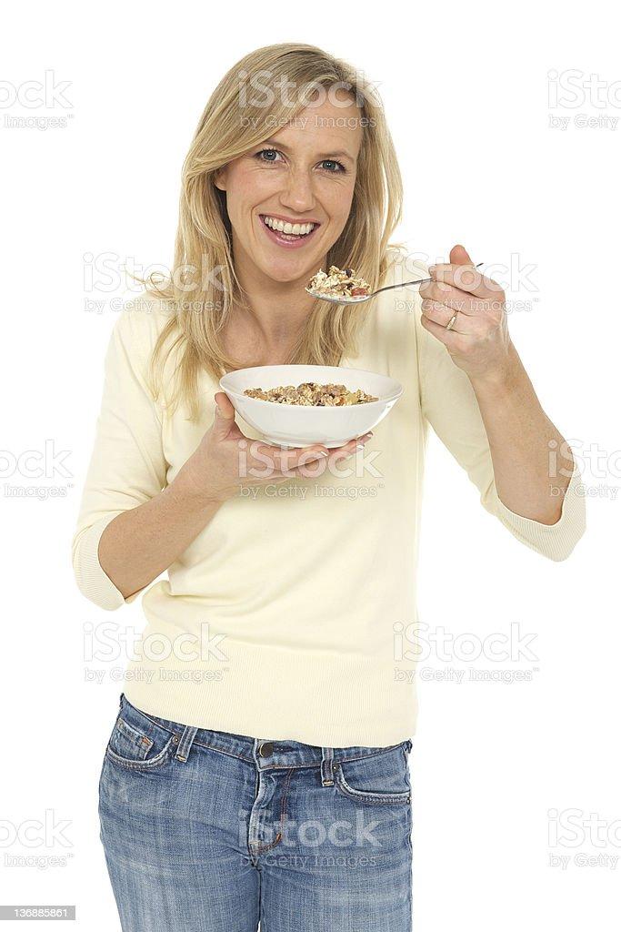 Woman eating muesli royalty-free stock photo