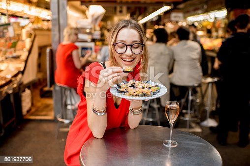 istock Woman eating mussels at the food market 861937706