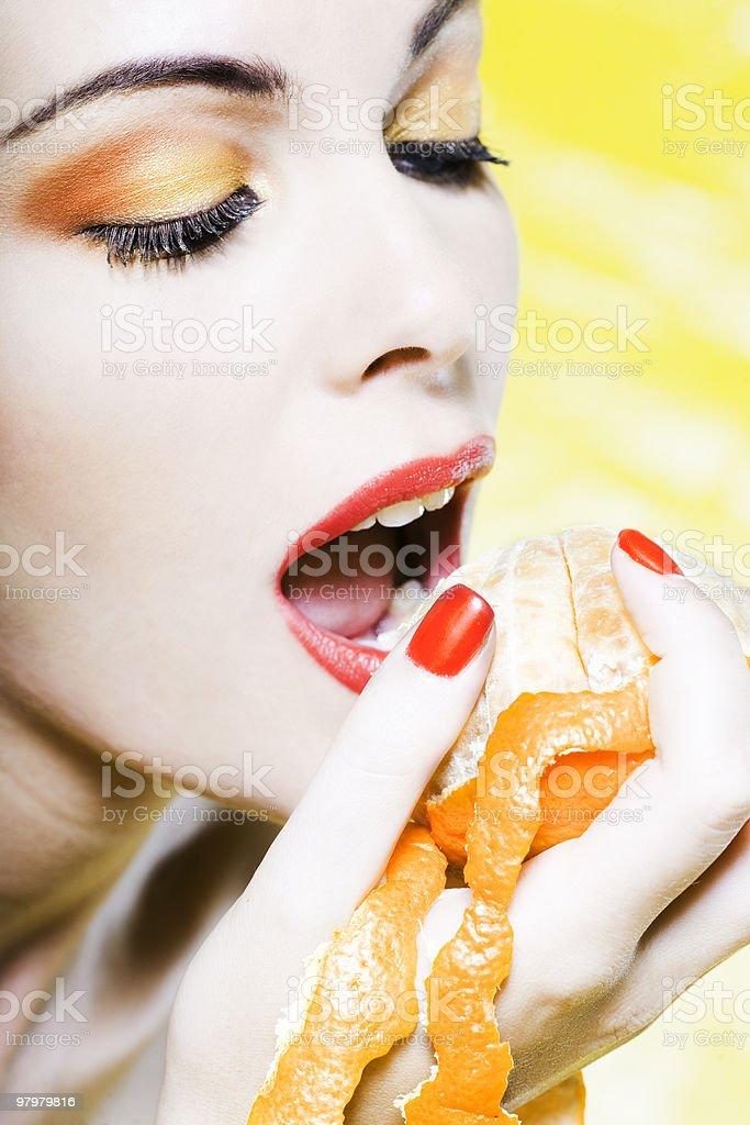 woman eating orange royalty-free stock photo