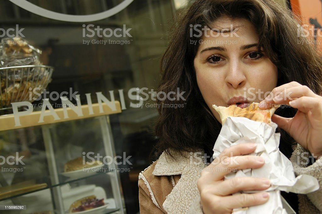 Woman Eating Panini royalty-free stock photo