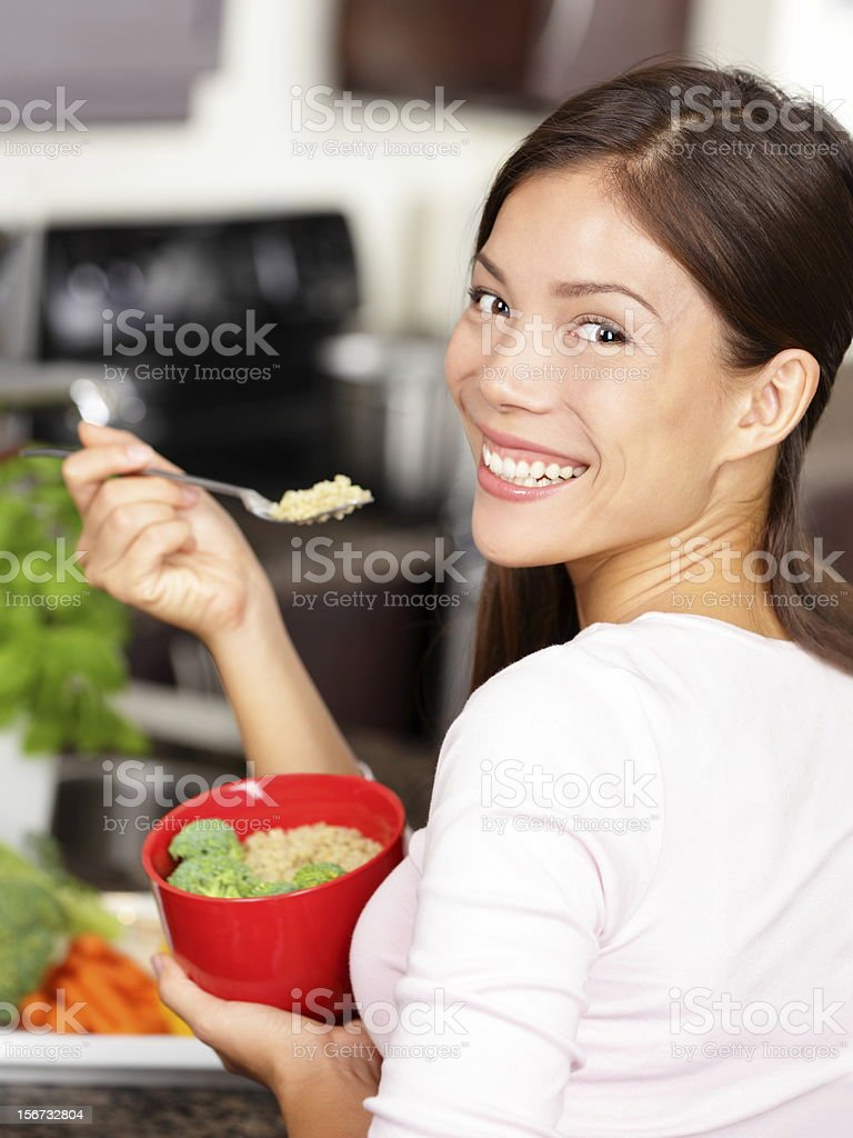 woman eating quinoa salad stock photo