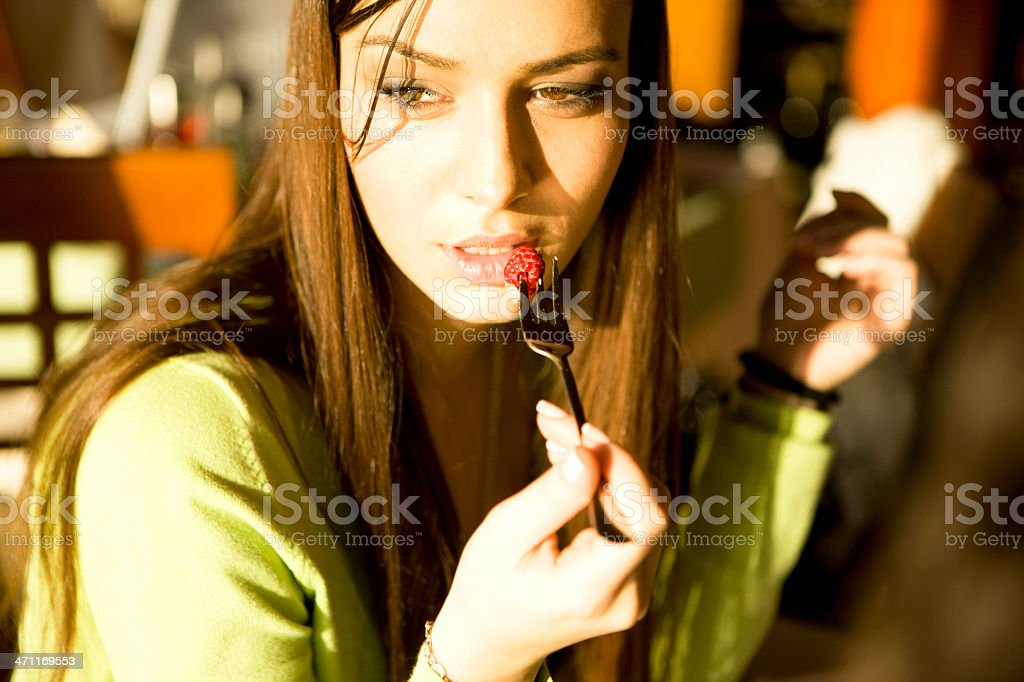 Woman Eating Raspberry royalty-free stock photo