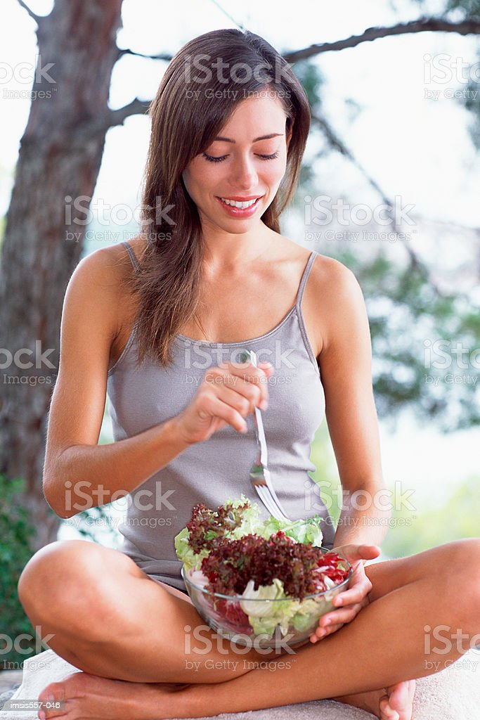 Woman eating salad in garden 免版稅 stock photo