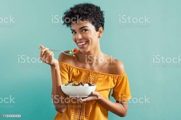 Woman eating salad picture id1134000433?b=1&k=6&m=1134000433&s=612x612&h=99ueovsojvpoeugrfdziltjzwdwhkroupwskavcfnpw=