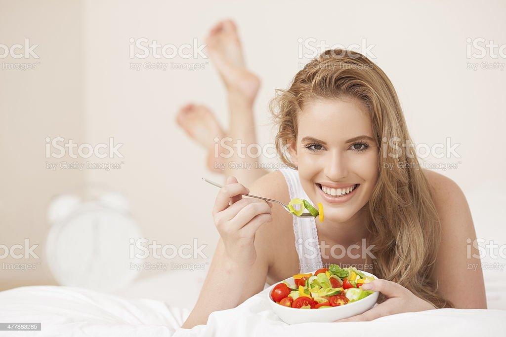 Woman eating salad. royalty-free stock photo