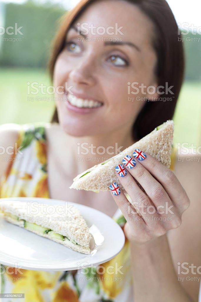 Woman Eating Sandwich stock photo