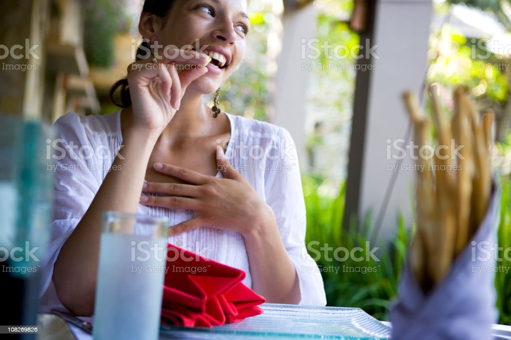Woman eating snack royalty-free stock photo
