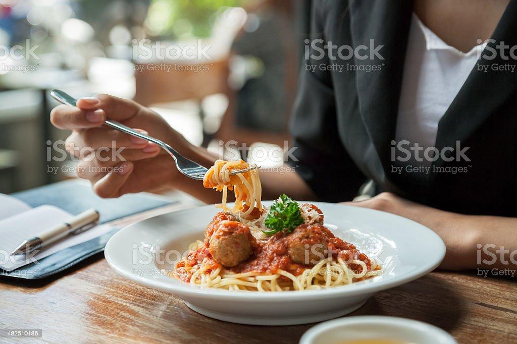 woman eating spaghetti stock photo