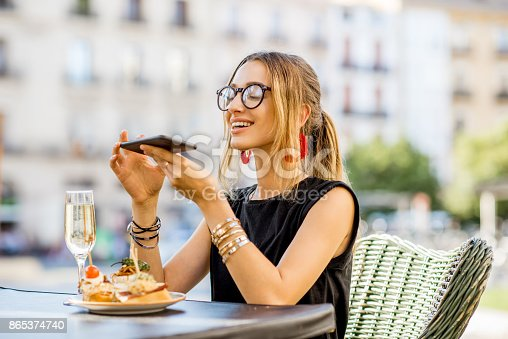 istock Woman eating spanish pinchos at the bar outdoors 865374740
