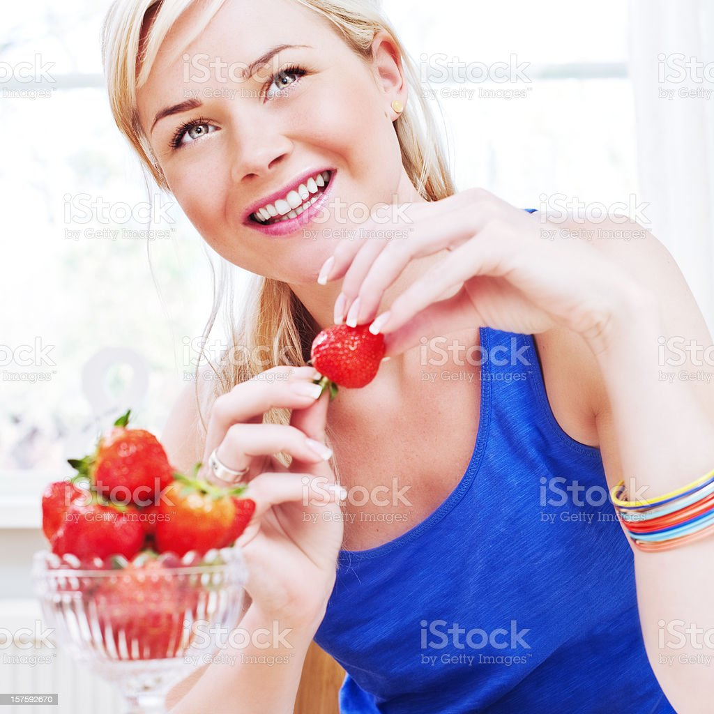 Woman eating strawberries royalty-free stock photo